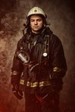 Firefighter in a smoke Stock Photography