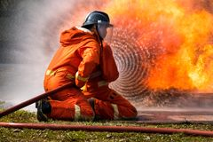 Firefighter splash water to fire hydrant. Firefighter is spraying water to extinguish the fire in training center Stock Images