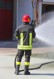 Firefighter sprays water with the spear fighting during the exer Stock Photography