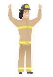 Firefighter standing with raised arms up. Successful caucasian firefighter standing with raised arms up. Successful firefighter giving thumbs up. Firefighter Stock Photography