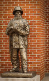 Firefighter Statue. A bronze statue of a firefighter outside a fire station royalty free stock image