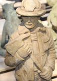 Firefighter Stone Statue. Firefighter Stone Sculpture taken at a garden center royalty free stock photos