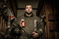Firefighter in storage room Stock Photography