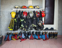 Firefighter Suits Arranged At Fire Station Stock Photo