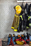 Firefighter Suits At Fire Station. Firefighter suits and equipment arranged at fire station Stock Images