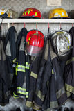 Firefighter Suits And Helmets At Fire Station Royalty Free Stock Photos