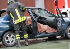 Firefighter team pulls the man wounded by the car after a road a Stock Image