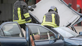 Firefighter team takes off the car roof to pull the wound after Royalty Free Stock Photos