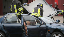 Firefighter team takes off the car roof to pull the wound after Stock Photography