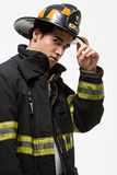 Firefighter tipping his hat Stock Photos