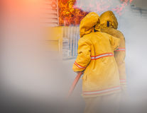 Firefighter. In to the fire, a Firefighter searches for possible survivors stock images