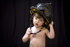 Firefighter toddler 1 Royalty Free Stock Images