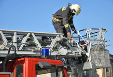 Firefighter on the top of a fire truck Royalty Free Stock Photos