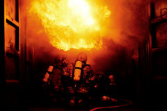 Firefighter training. Firefighters training firefighting inside flash over container Royalty Free Stock Image
