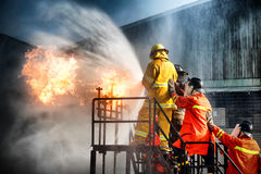 Firefighter training. The Employees Annual training Fire fighting Royalty Free Stock Photos