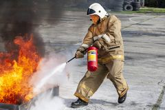 Firefighter during training with a huge fire in the brazier stock image