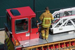 Firefighter on truck no face stock photo