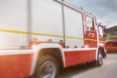 Firefighter truck speed composing. A firefighter truck speed composing Stock Photo