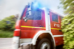 Firefighter truck speed composing. A firefighter truck speed composing Royalty Free Stock Images