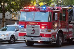 Firefighter truck on the street royalty free stock photo