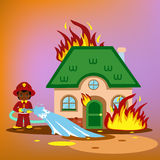 Firefighter trying to put out burning house. Royalty Free Stock Image
