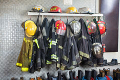 Firefighter Uniforms Arranged At Fire Station. Firefighter's uniforms and gear arranged at fire station Stock Image