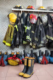 Firefighter Uniforms At Fire Station Royalty Free Stock Images
