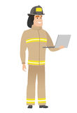 Firefighter using laptop vector illustration. Caucasian firefighter in uniform using laptop. Full length of young firefighter working on a laptop. Cheerful Stock Images