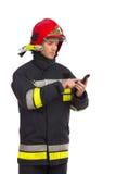 Firefighter using smart phone. Stock Photos