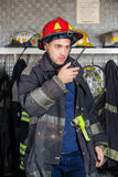 Firefighter Using Walkie Talkie At Fire Station Stock Photos