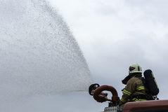Firefighter. Using water cannon on the firetruck Stock Photo