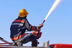 Firefighter with a water cannon. Extinguishes a fire Royalty Free Stock Photography