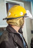 Firefighter Wearing Yellow Helmet At Fire Station Royalty Free Stock Photography
