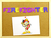 Firefighter word on a corkboard Stock Image