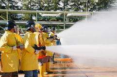 Firefighter. Work,Fire department, , flame, burn, explode, fight, water, water stream Stock Photography