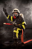 Firefighter at work Stock Photos