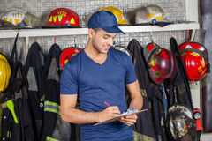 Firefighter Writing On Clipboard Stock Photography