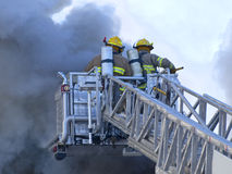 Firefighters. Ladder truck with two firefighters Royalty Free Stock Images