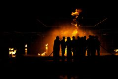 Firefighters. In structure approaching fire Stock Photography