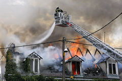 Firefighters. In action trying to save the house Stock Images