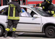 Firefighters in action after the accident Royalty Free Stock Images