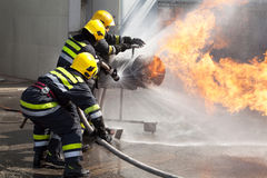 Firefighters in action. Firefighters attack a propane fire during a training exercise Stock Image