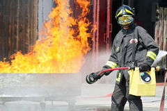 Firefighters in action during an exercise in the Firehouse Stock Images