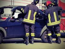 Firefighters in action. Firefighters freed the wounded man inside the car after car crash Royalty Free Stock Photo