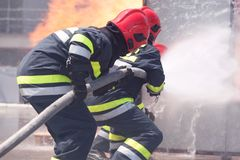 Firefighters in action. Firefighting. Royalty Free Stock Images