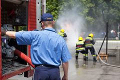 Firefighters in action. Firefighting. Stock Photo