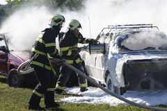 Firefighters in action Stock Photography