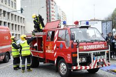 Firefighters on action. Firetruck on accident scenery with firefighters start action rescue Royalty Free Stock Photography