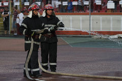 Firefighters in action. During football game on Stefan cel Mare Arena, Bucharest, Romania Royalty Free Stock Photo