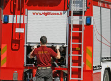Firefighters in action opens a truck with equipment Royalty Free Stock Photos